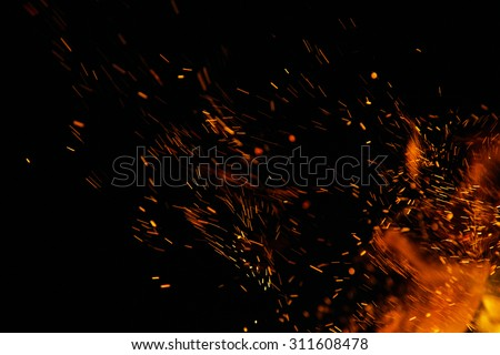 fire flames with sparks on a black background - stock photo