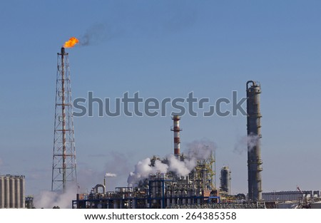 Fire from a gas torch, in the chemical industry - stock photo