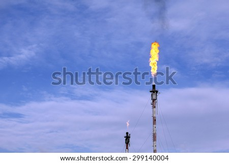 Fire from a gas torch, in the oil industry - stock photo
