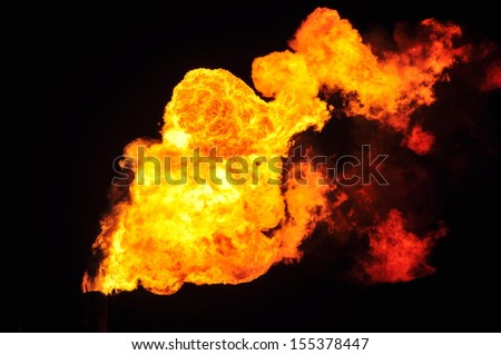 Fire from an oil refinery.
