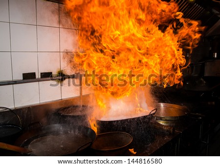 Fire gas burn is cooking on iron pan,stir fire very hot