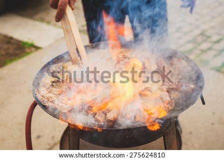 FIRE, Grilled meat, BBQ, mixed meat on the grill. Sausages. Kebab.  - stock photo