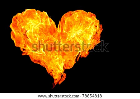 Fire Heart in darkness - stock photo