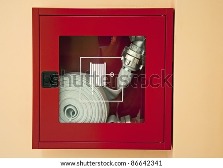 Fire hose into the wall - stock photo