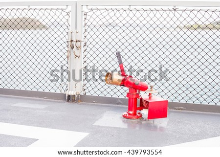 Fire hose on boat - stock photo