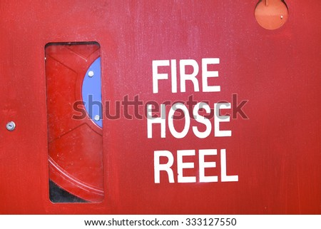 fire hose reel prepared in school safety - stock photo