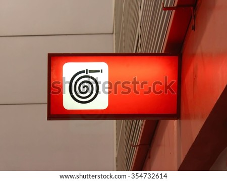 Fire Hose Sign, Fire Hose Symbol - stock photo