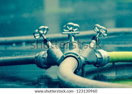 fire hoses in extinguishing water - stock photo
