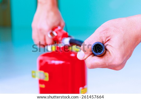 fire hydrant,extinguisher,fire brigade,fire extinguisher,fire fighter,FIRE fire brigade,FIRE fire extinguisher,FIRE fire station,fireboat,fireman,stoker,The use of fire extinguishers The availability. - stock photo