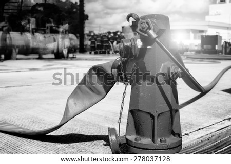fire hydrant , hose connection ,fire fighting equipment for fire fighter black and white tone. - stock photo