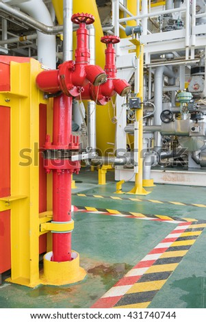 fire hydrant , hose connection ,fire fighting equipment for fire fighter in oil and gas platform - stock photo