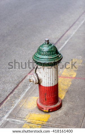 Fire hydrant in Italian flag colors, Little Italy, New York City, USA. - stock photo