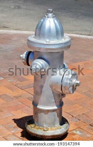 fire hydrant is a fire protection source of water provided in most urban, with municipal water service to enable firefighters to tap into the municipal water supply to assist in extinguishing a fire. - stock photo