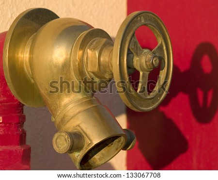 Fire hydrant on the red background. Egypt - stock photo