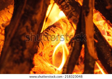 Fire in a fireplace. Closeup with shallow DOF. - stock photo