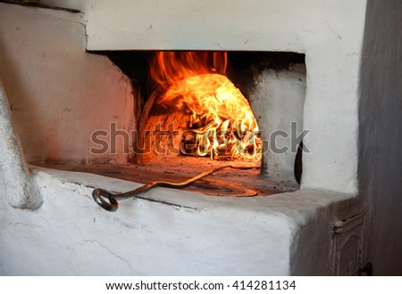 fire in a traditional oven for cooking baking