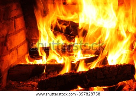 Fire in burning fireplace in winter close-up