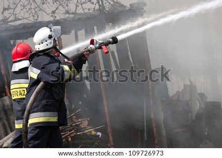 fire in small village in Poland, rescue action