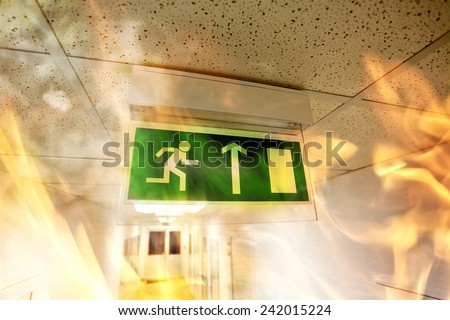 Fire in the building - emergency exit - stock photo