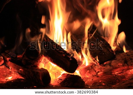 Fire in the hearth burning brightly. Natural photo story. Perfect illustration hot for your page magazine - stock photo