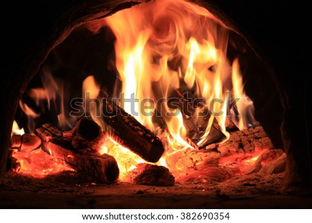 Fire in the hearth burning brightly. Traditional farmhouse fireplace. Natural photo story. Perfect illustration hot for your page magazine
