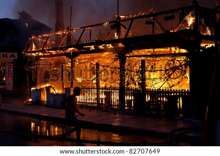 Fire in the night. Two restaurants and one three-floor house burnt out in that fire. - stock photo