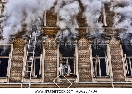 fire in the old house. window facade close-up - stock photo