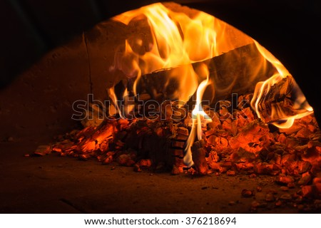 fire in the oven.  Traditional Pizza oven - stock photo