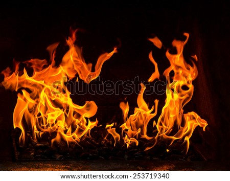 fire in the oven with coal on the black background - stock photo