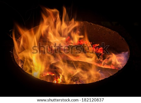 fire in the round fireplace
