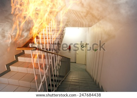 Fire in the staircase in the office - stock photo