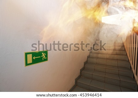 Fire int the building - emergency exit - stock photo