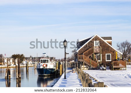 Fire Island ferry docked at Davis park in the winter. Long Island, New York. - stock photo