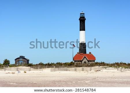 Fire Island Lighthouse and Lens Room located on Fire Island National Seashore, Long Island, New York - stock photo
