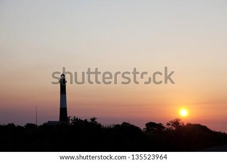 Fire Island Lighthouse at sunrise. Fire Island National Seashore Long Island, New York. - stock photo