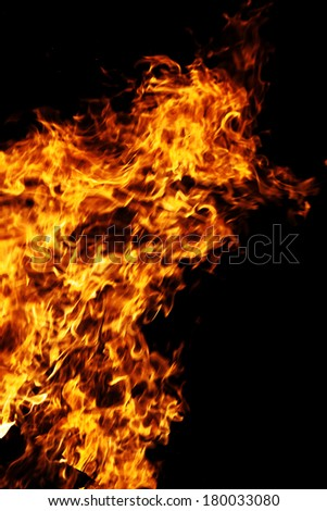 Fire isolated on a black background. - stock photo