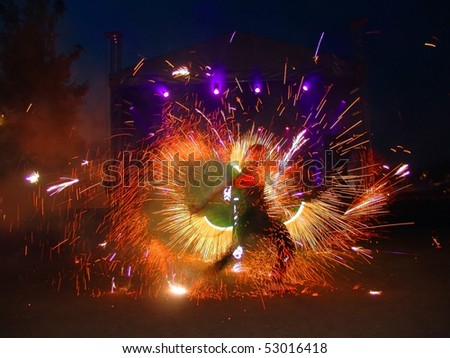 Fire juggler light during yacht festival in Moscow - stock photo