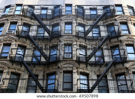 Fire ladder at old beautiful houses in new York - stock photo