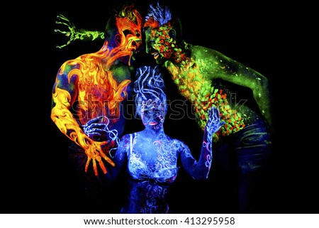Fire, Land and Air. Body art glowing in ultraviolet light, four elements, isolated on black background - stock photo