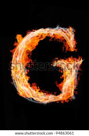 "fire letter ""G"" - stock photo"