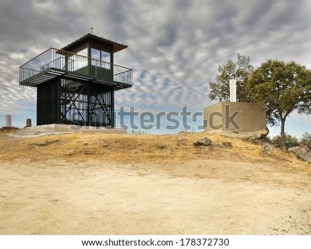Fire lookout tower in Cabeza de la Huerta hill in Robledo de Chavela. Madrid. Spain. Europe. - stock photo