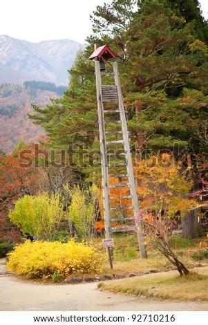 Fire lookout tower in traditional Japanese village Shirakawa-go, Gifu prefecture, Japan - stock photo