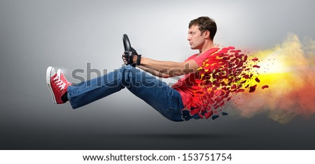 Fire man car driver in gloved with a wheel, auto concept  - stock photo