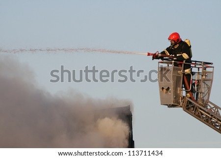 Fire man in a action - stock photo
