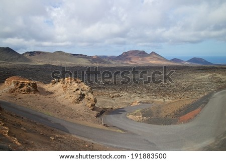 Fire mountains and barren volcanic lava landscape in Timanfaya national park, Lanzarote island, Spain - stock photo