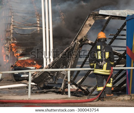 Fire of buildings. Fireman at work. - stock photo