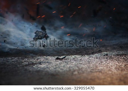 Fire of spark smoke ashes on wind - stock photo