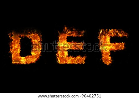 Fire on letter DEF - stock photo