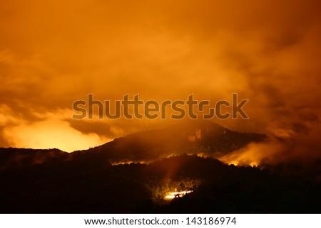 Fire on Volcanic Mountain - stock photo