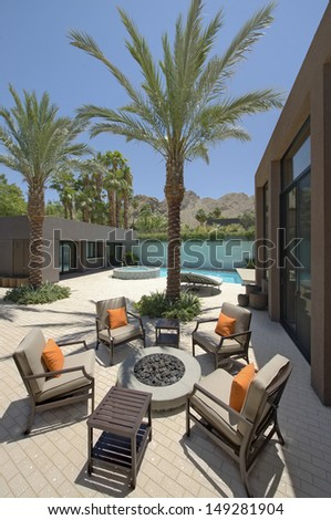 Fire pit surrounded by chairs of Californian home - stock photo